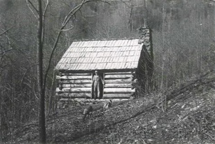 A man in the doorway of the Caudill Cabin